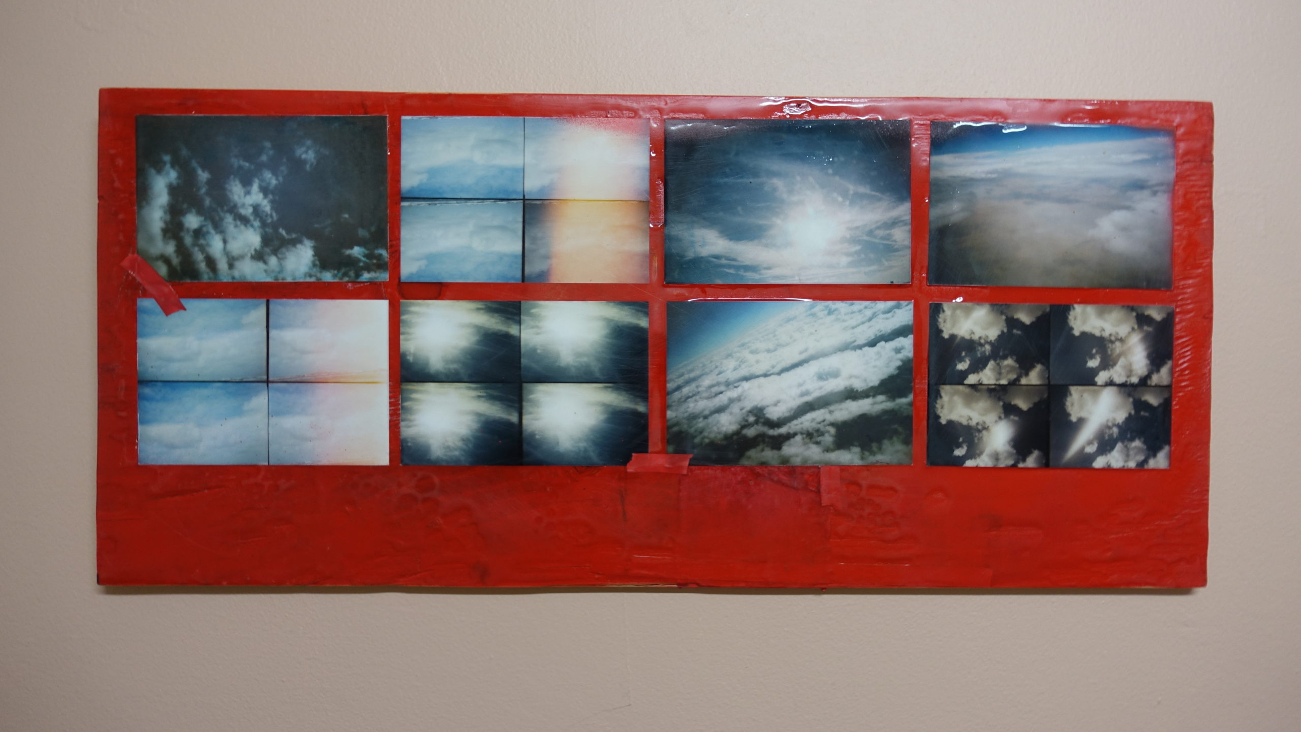 cloud#8 - 27x12 inches. 35mm toy camera photos on wood covered in casting resin.